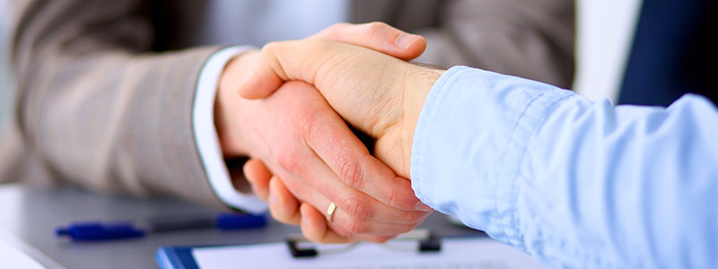 Closeup of a business handshake , on white background
