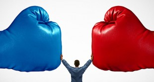 Mediate and legal mediation business concept as a businessman or person separating two boxing glove opposing competitors as an arbitration success symbol for finding common interests to lawfully solve a conflict.